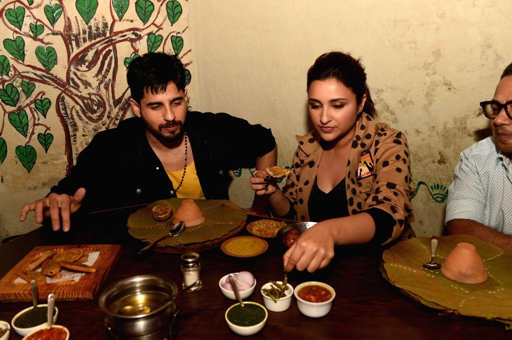 "Lucknow: Actors Sidharth Malhotra and Parineeti Chopra enjoy food at a restaurant during their visit to Lucknow to promote their film ""Jabariya Jodi"", on July 27, 2019. (Photo: IANS) - Sidharth Malhotra and Parineeti Chopra"