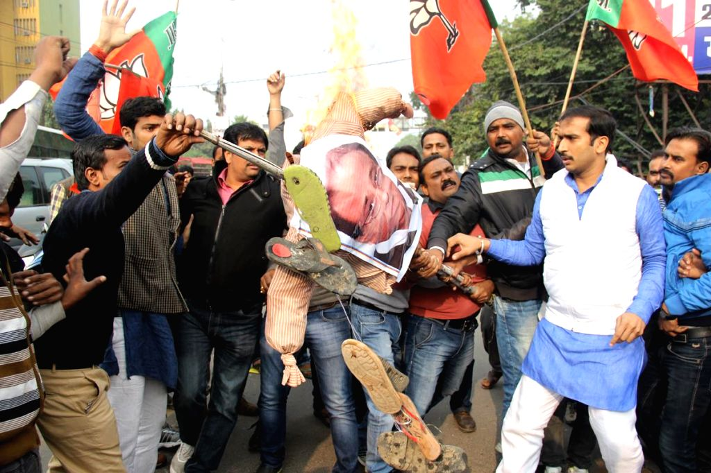 BJP workers burn effigies of Uttar Pradesh Urban Development Minister and Samajwadi Party leader Mohd. Azam Khan during a demonstration to demand action against him in Lucknow, on Dec 15, ...