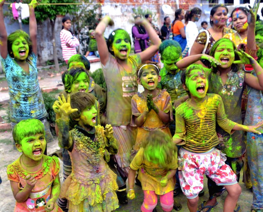 Children celebrate holi in Lucknow on March 2, 2015.