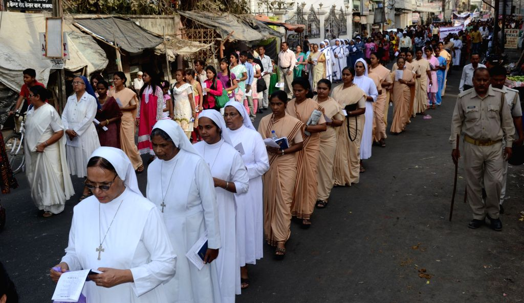 Christian nuns participate in an Easter procession in Lucknow, on April 5, 2015.