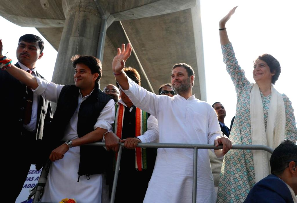 Lucknow: Congress leaders Rahul Gandhi, Priyanka Gandhi Vadra and Jyotiraditya Scindia during a road show in Lucknow on Feb 11, 2019. (Photo: IANS/AICC) - Rahul Gandhi and Priyanka Gandhi Vadra