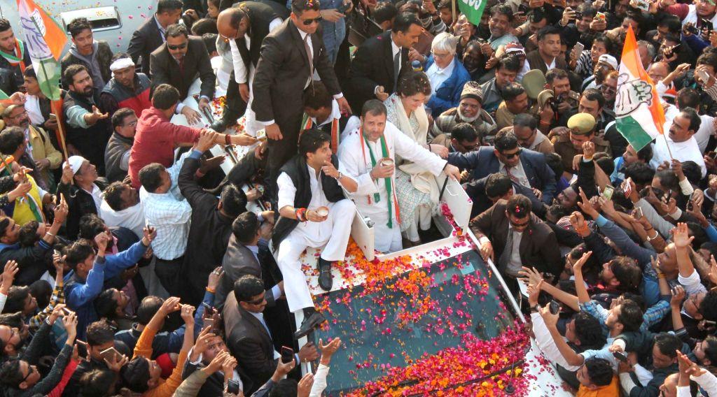 Lucknow: Congress leaders Rahul Gandhi, Priyanka Gandhi Vadra and Jyotiraditya Scindia during a road show in Lucknow on Feb 11, 2019. (Photo: IANS) - Rahul Gandhi and Priyanka Gandhi Vadra