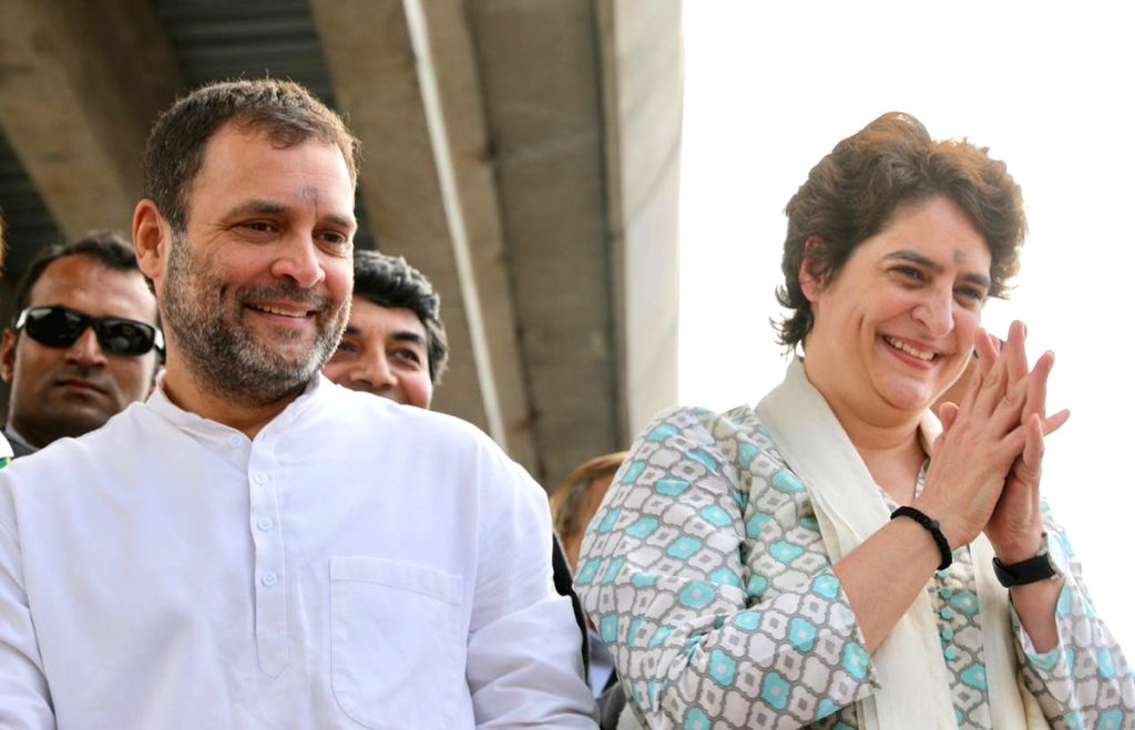 Lucknow:  Congress President Rahul Gandhi and his sitser Priyanka Gandhi Vadra during a road show in Lucknow on Feb 11, 2019. (Photo: IANS/AICC) - Rahul Gandhi and Priyanka Gandhi Vadra