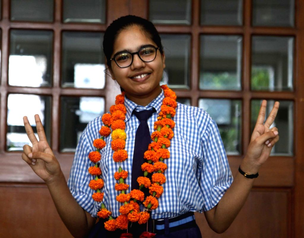Lucknow:Divyanshi Jain, the class 12 student of the Arts stream who topped the CBSE Board examinations by scoring 600 out of 600 to get 100%, in Lucknow on July 13, 2020. (Photo: IANS) - Divyanshi Jain