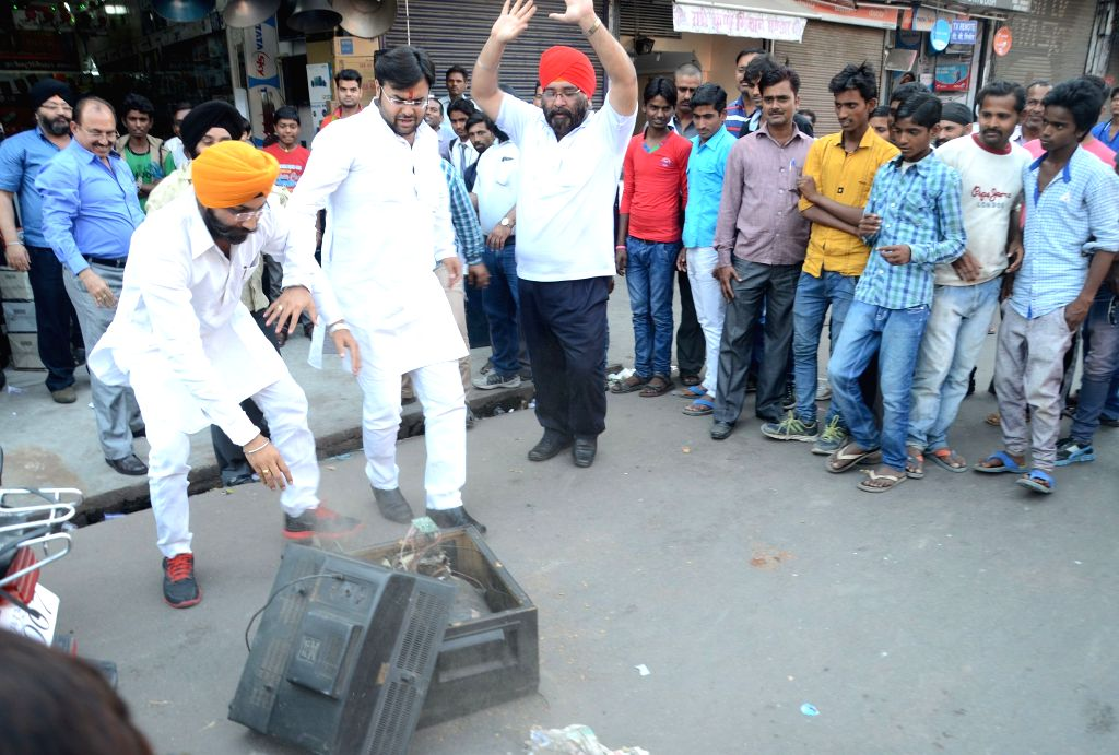 Indian cricket fans break television sets in Lucknow after the the team lost to Australia in the World Cup 2015 semi-final, on March 26, 2015.
