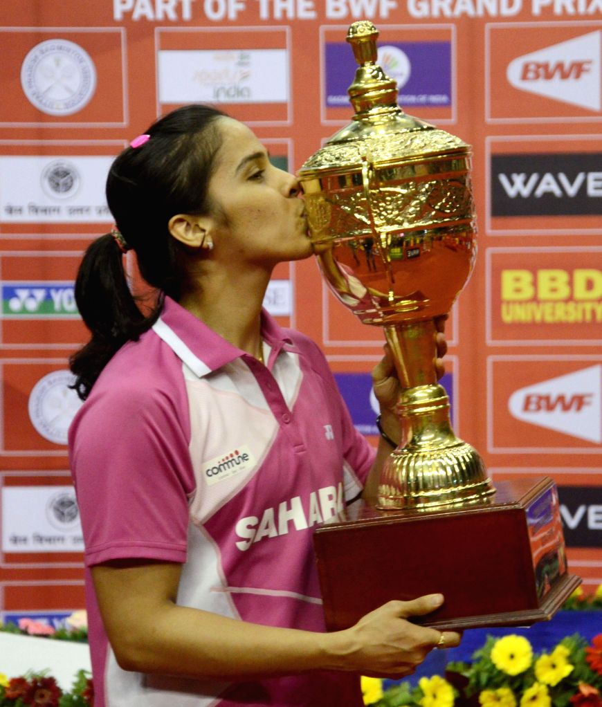 Indian shuttler Saina Nehwal kisses the trophy after winning Syed Modi International Grand Prix Gold Badminton Championship in Lucknow, on Jan 25, 2015.