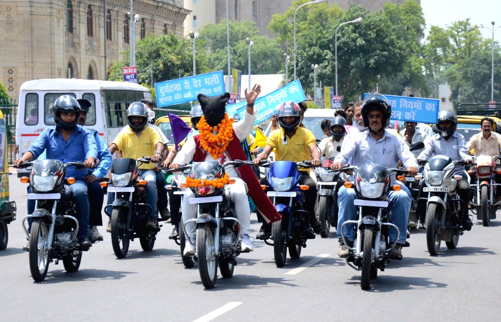 Magician O P Sharma (blindfolded) participates in a bike rally to promote road safety in Lucknow, on April 29, 2015.