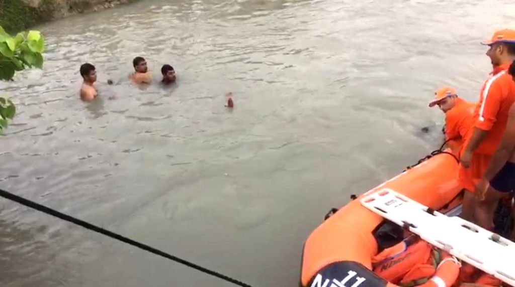 Lucknow: National Disaster Response Force (NDRF) personnel carry out rescue operations at the the canal where an SUV carrying 29 people fell, in Lucknow on June 20, 2019. Seven children are feared dead in the accident. All the passengers were returni