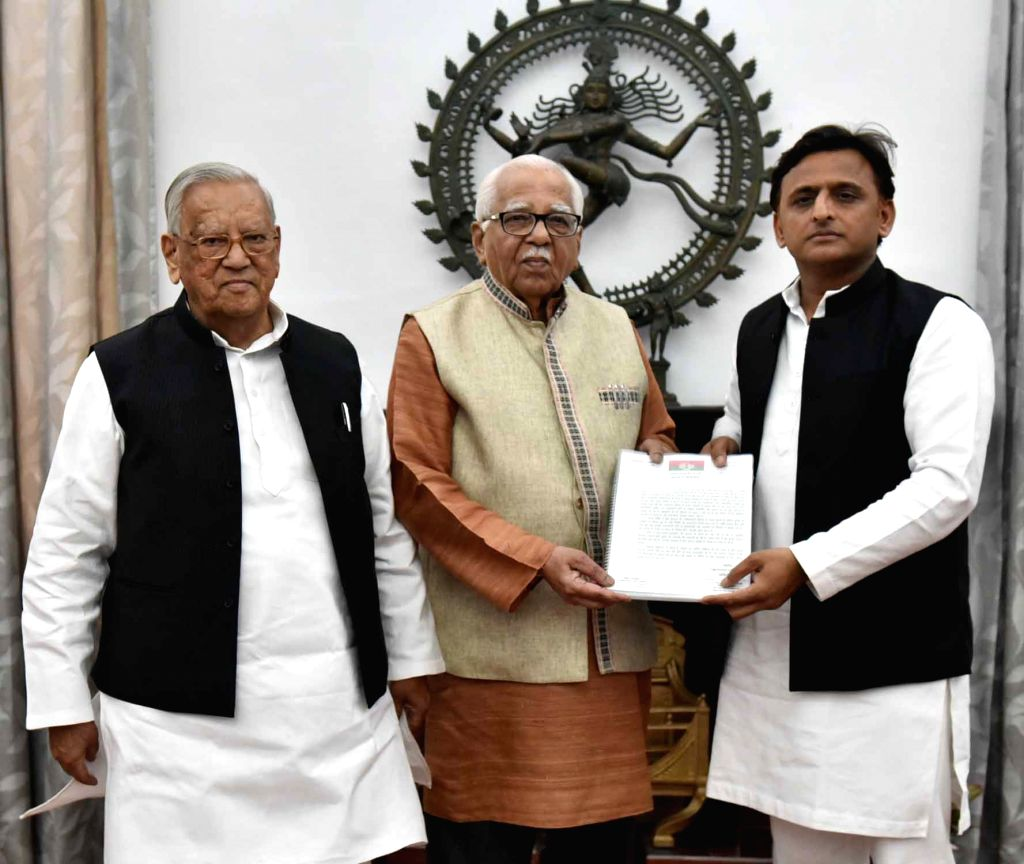 Lucknow: Samajwadi Party President Akhilesh Yadav accompanied by party leader Ahmad Hasan, meets Uttar Pradesh Governor Ram Naik and submits a memorandum over the law and order situation in the state, in Lucknow on June 15, 2019. (Photo: IANS) - Akhilesh Yadav