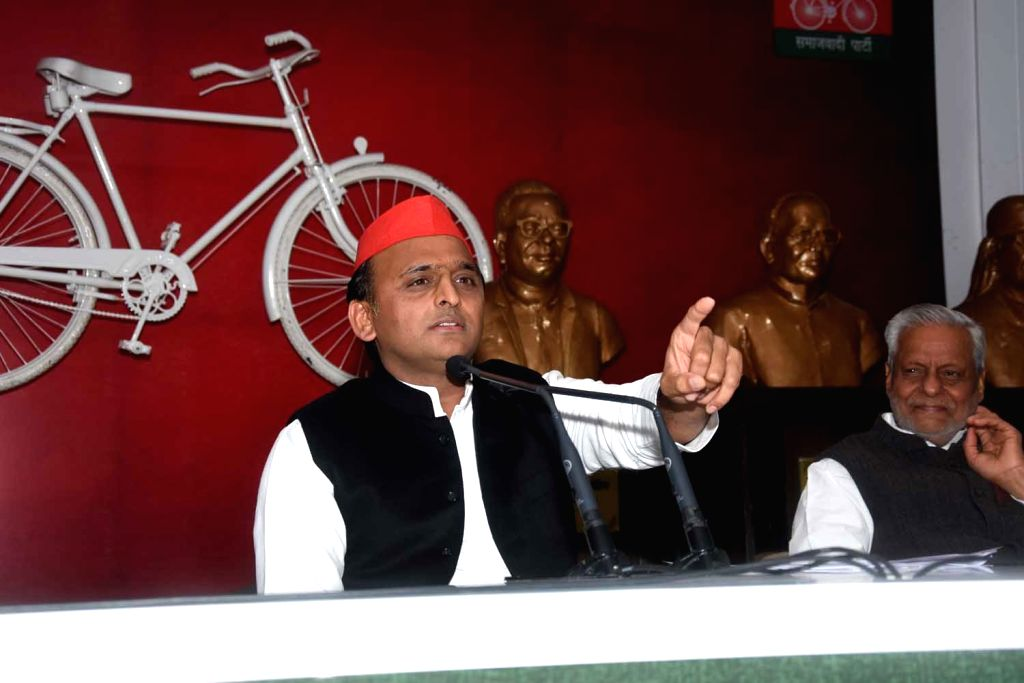 Lucknow: Samajwadi Party (SP) chief Akhilesh Yadav addresses a press conference at the party office in Lucknow, on Dec 30, 2018. (Photo: IANS) - Akhilesh Yadav