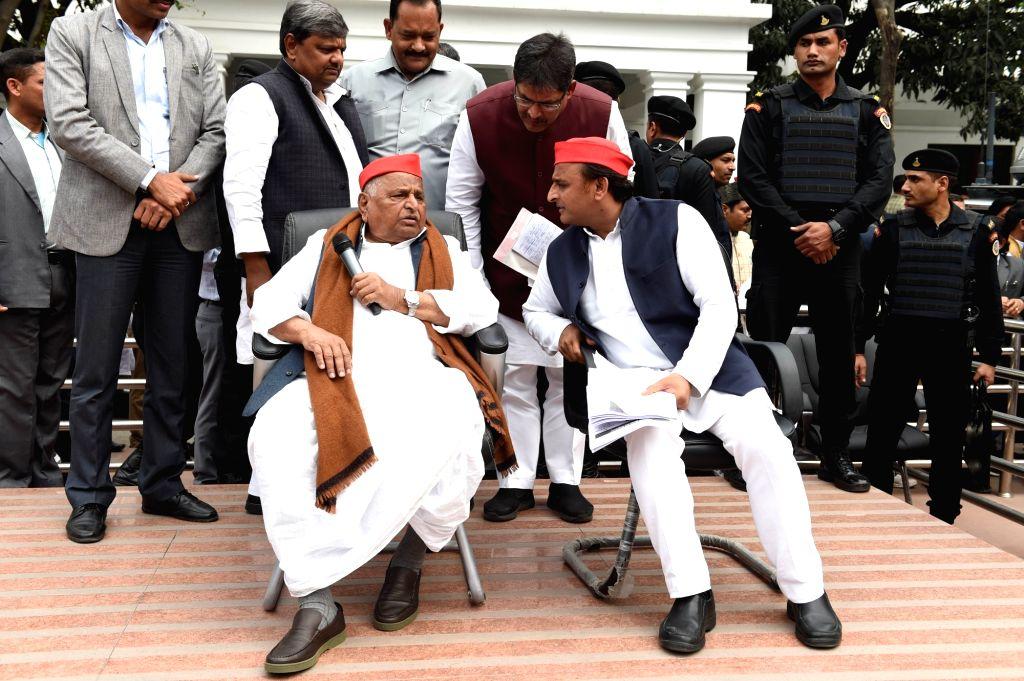 Lucknow: Samajwadi Party (SP) leaders Mulayam Singh Yadav and Akhilesh Yadav at party office in Lucknow on Feb 21, 2019. (Photo: IANS) - Mulayam Singh Yadav and Akhilesh Yadav