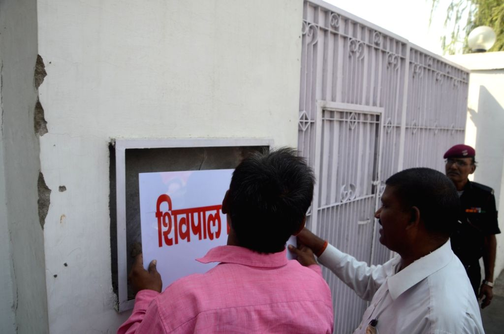 Lucknow: Samajwadi Party (SP) Uttar Pradesh unit President Shivpal Yadav's name plate being removed from his official residence after he was sacked from Uttar Pradesh cabinet in Lucknow on ... - Shivpal Yadav