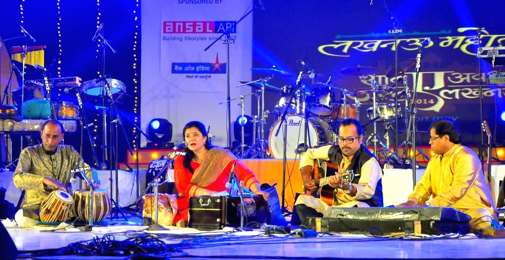 Singer Dr. Seema Mishra and others perform during the Lucknow Mahotsav on Dec 2, 2014.
