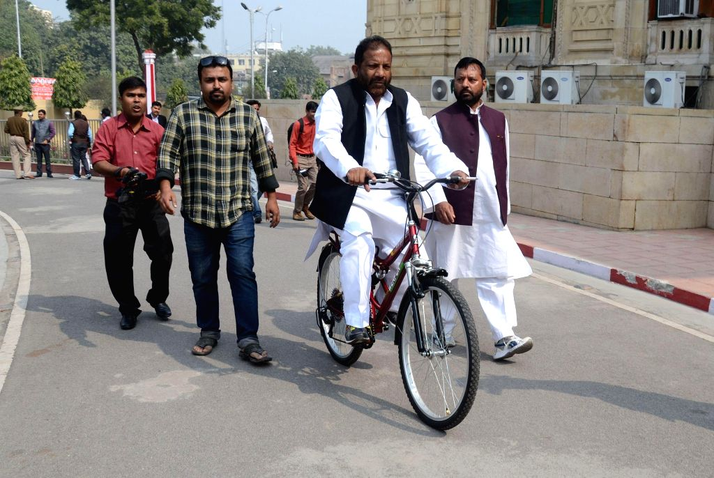 SP MLA Jahid Jamal Beg arrives at the Uttar Pradesh Legislative Council riding a bicycle on Feb 18, 2015.