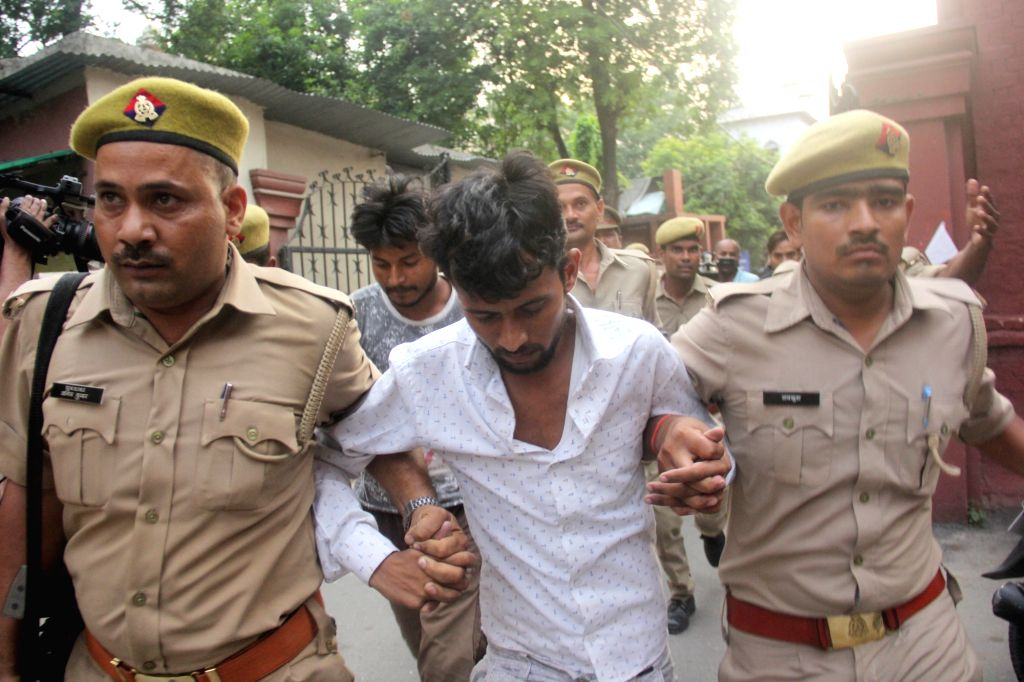 Lucknow: The driver and cleaner of the truck that hit the car in which the Unnao rape victim was travelling along with her two aunts and lawyer, being taken to be presented before special court in Lucknow on Aug 2, 2019. (Photo: IANS)