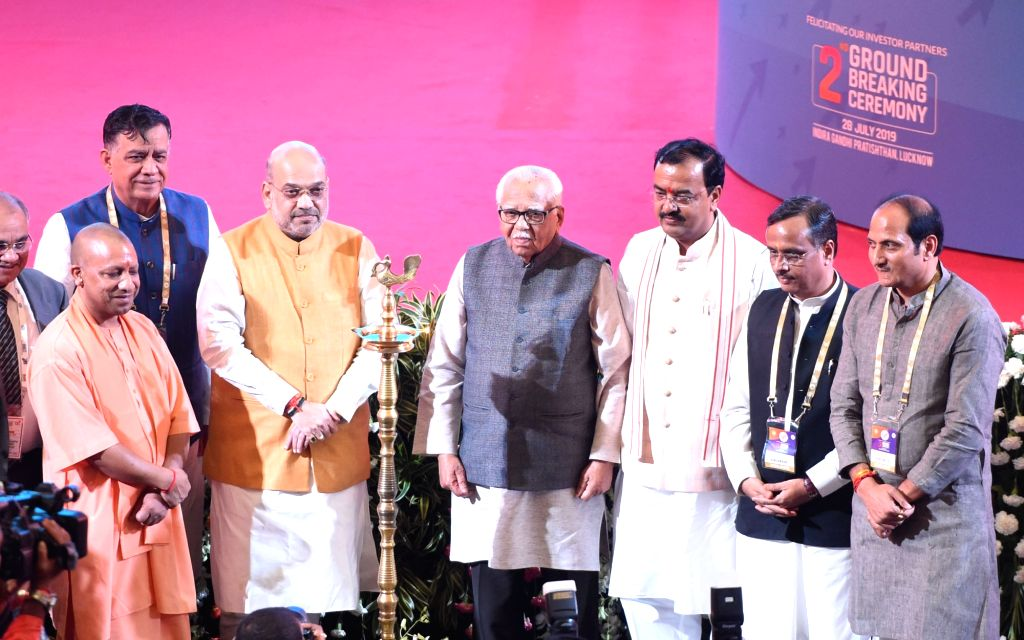 Lucknow: Union Home Minister Amit Shah, Uttar Pradesh Governor Ram Naik, Chief Minister Yogi Adityanath, Deputy Chief Ministers Dinesh Sharma and Keshav Prasad Maurya during the 2nd Ground Breaking Ceremony of UP Investors Summit in Lucknow on July 2 - Amit Shah, Dinesh Sharma and Keshav Prasad Maurya