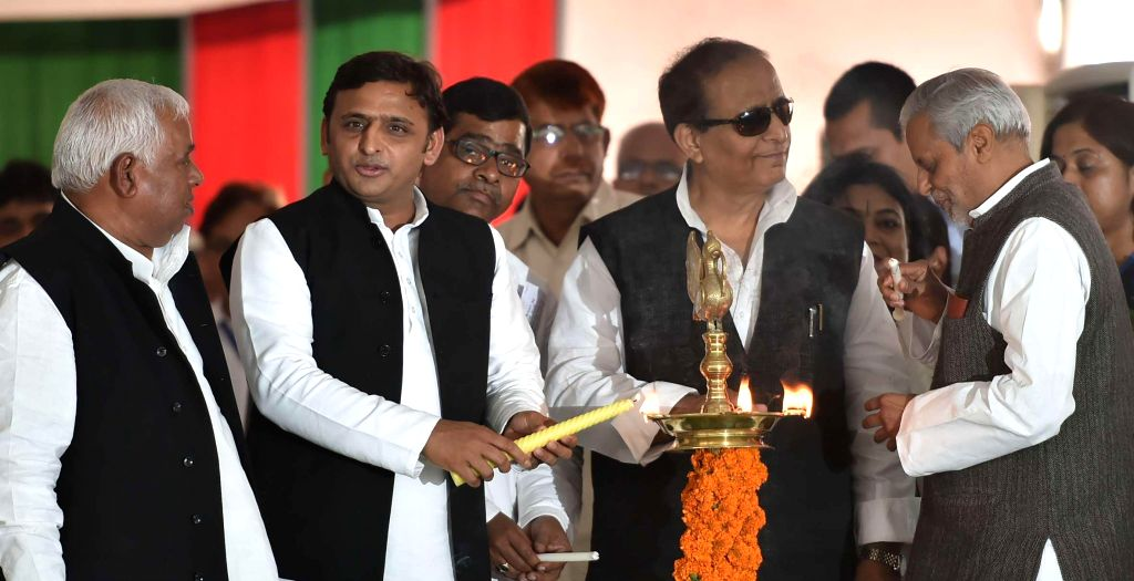 Uttar Pradesh Chief Minister Akhilesh Yadav with Samajwadi Party leader Azam Khan and others during a party programme in Lucknow, on Nov 5, 2014. - Akhilesh Yadav