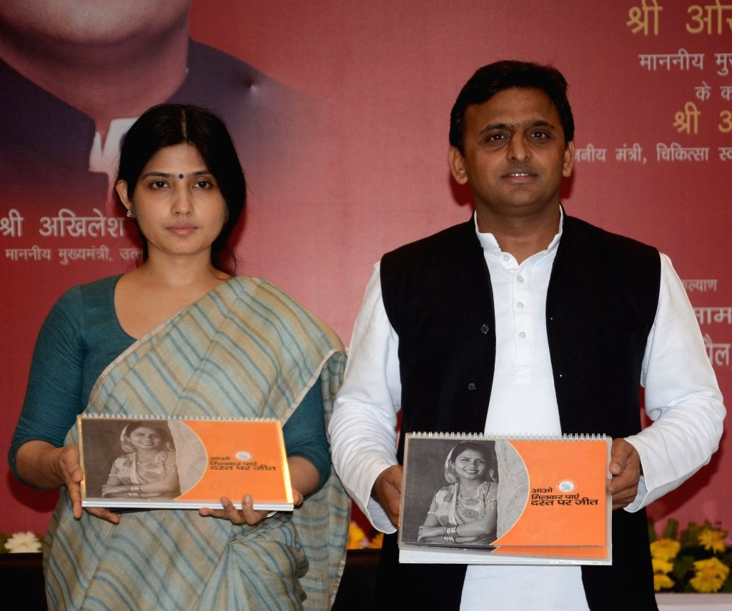 Uttar Pradesh Chief Minister Akhilesh Yadav and his wife and Kannauj MP Dimple Yadav during a book launch programme in Lucknow, on April 28, 2015. - Akhilesh Yadav