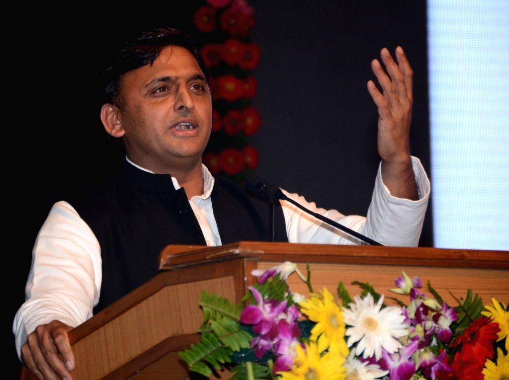 Lucknow: Uttar Pradesh Chief Minister Akhilesh Yadav addresses during a programme in Lucknow on Oct 10, 2016. (Photo: IANS) - Akhilesh Yadav