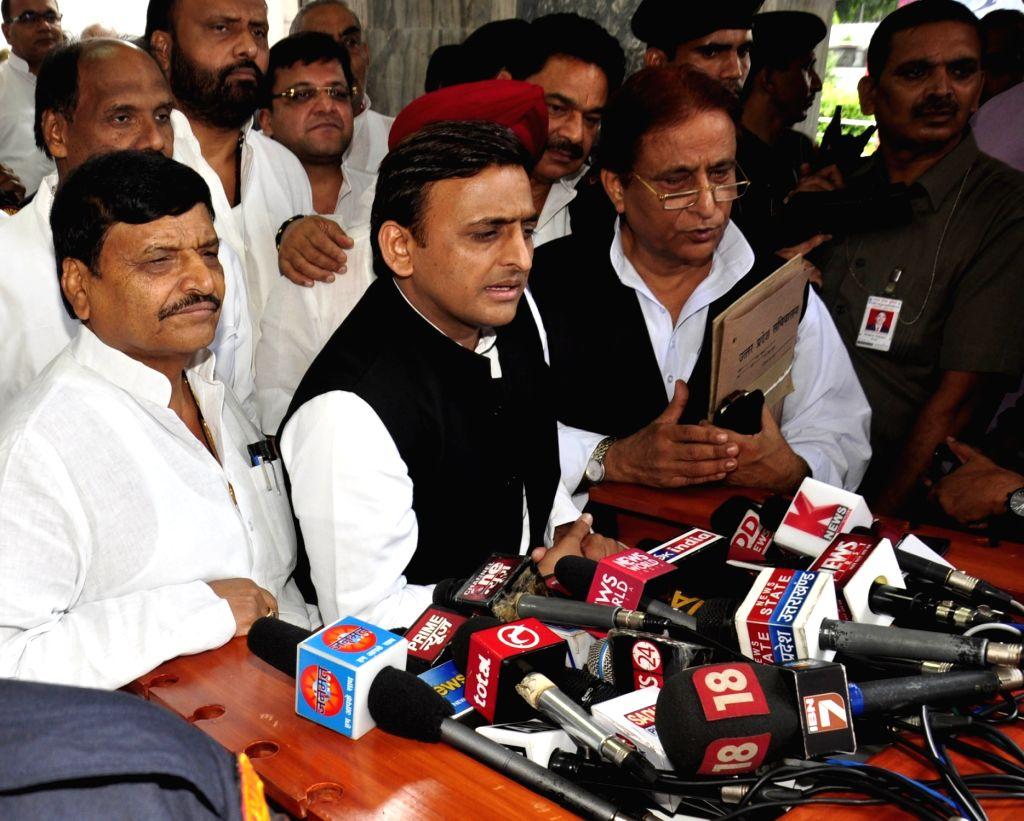 Lucknow: Uttar Pradesh Chief Minister Akhilesh Yadav talks to press after a cabinet meeting in Lucknow on Sept 20, 2016. Also seen Uttar Pradesh Samajwadi Party (SP) chief Shivpal Singh Yadav and national general secretary Mohammad Azam Khan. (Photo: - Akhilesh Yadav, Shivpal Singh Yadav and Azam Khan