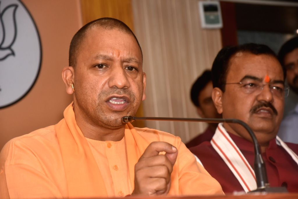 Lucknow: Uttar Pradesh Chief Minister Yogi Adityanath addresses a press conference at the state BJP headquarters in Lucknow, on May 24, 2019. Also seen Uttar Pradesh Deputy Chief Minister Keshav Prasad Maurya. (Photo: IANS) - Yogi Adityanath