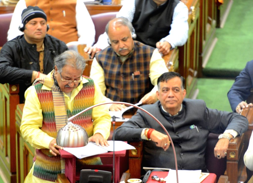 Lucknow: Uttar Pradesh Finance Minister Rajesh Agarwal presents the Budget 2019-20 in the state assembly, in Lucknow on Feb 7, 2019. The Yogi government on Thursday presented a Rs 4.79-lakh crore budget with focus on farmers by providing nearly Rs 1, - Rajesh Agarwal
