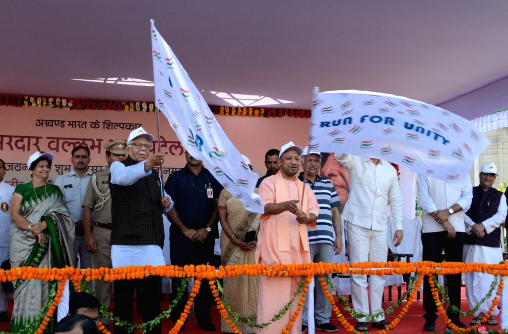 :Lucknow: Uttar Pradesh Governor Ram Naik and Chief Minister Yogi Adityanath flag off  'Run for Unity' marathon organised on the birth anniversary of the country's first Home ...