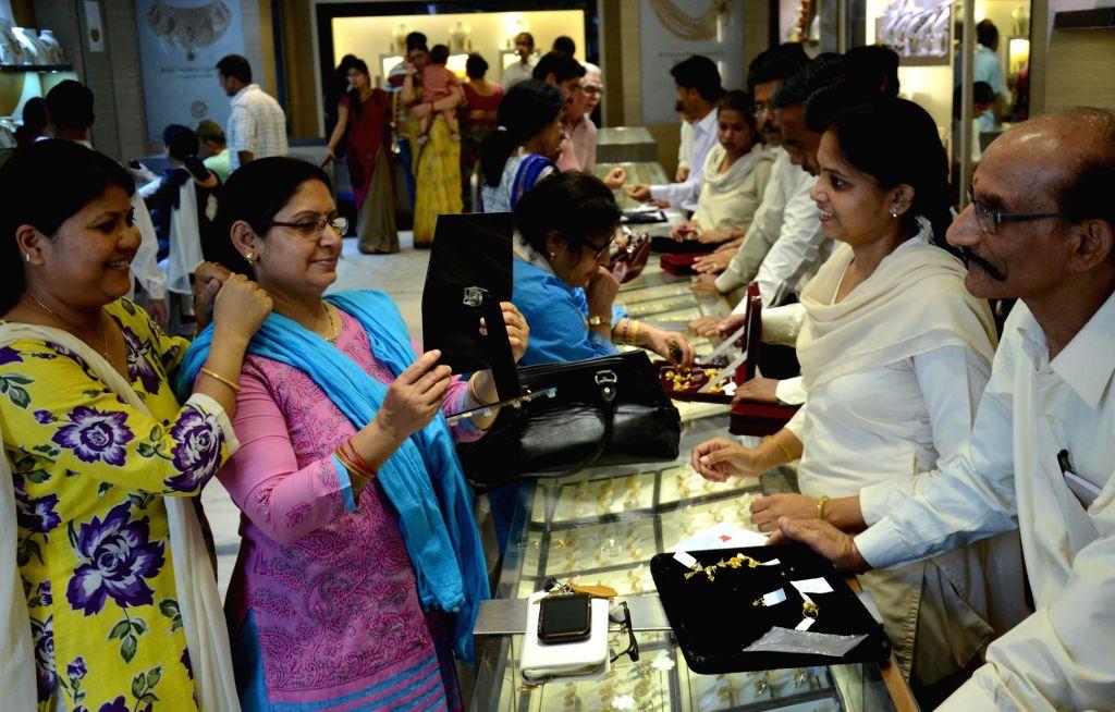 Women busy shopping at a Lucknow jewellery shop on Akshaya Tritiya on April 21, 2015.