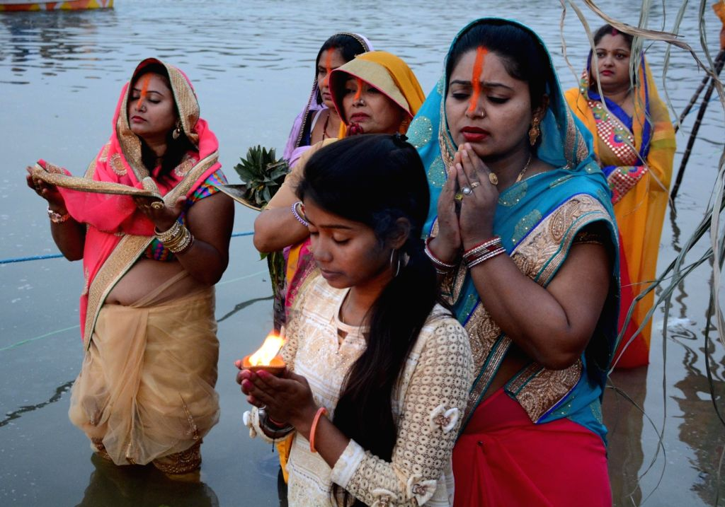 Lucknow : Women perform Chhath Puja rituals in Lucknow on Nov 17, 2015.