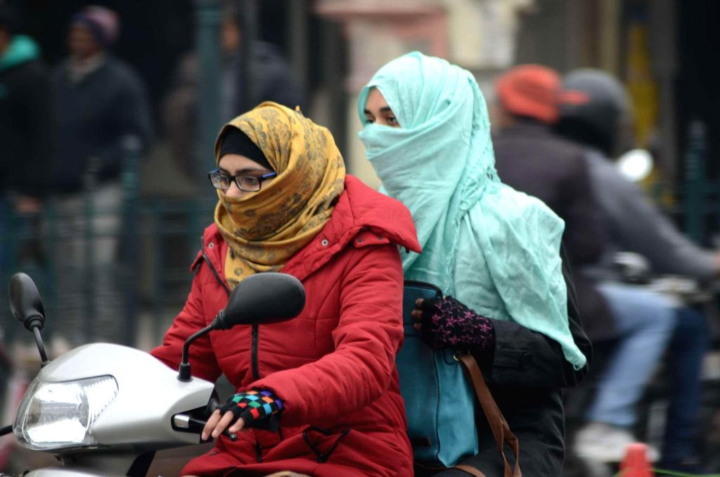 Women wear winter clothes to beat the cold in Lucknow on Jan 10, 2015.