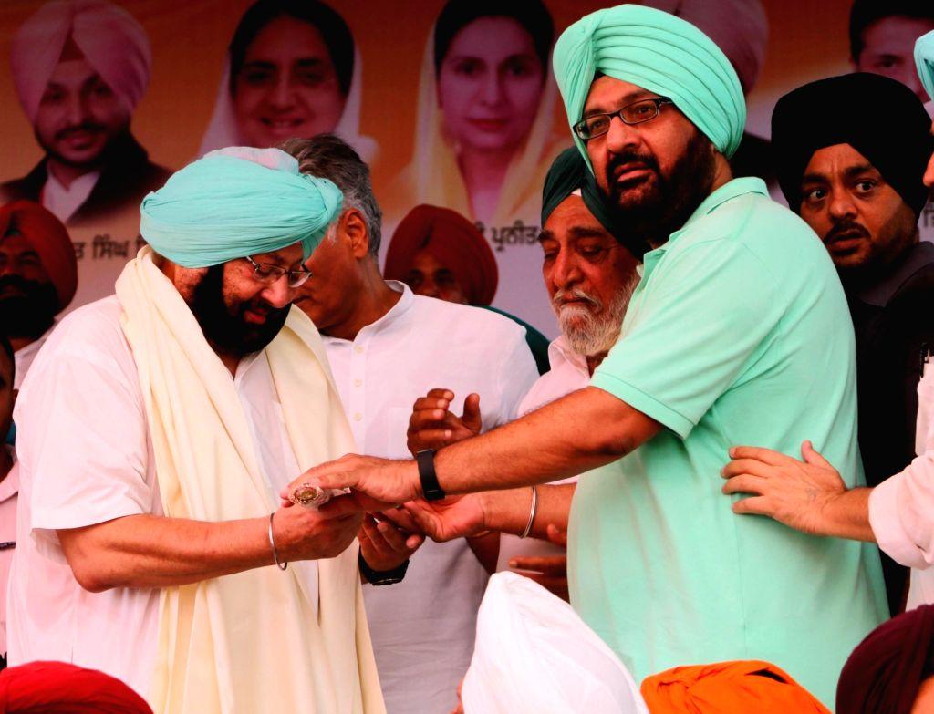 Ludhiana: Punjab Congress chief Captain Amarinder Singh during a party rally at Chappar near Mandi Ahmedgarh in Ludhiana on Sept 16, 2016. - Amarinder Singh