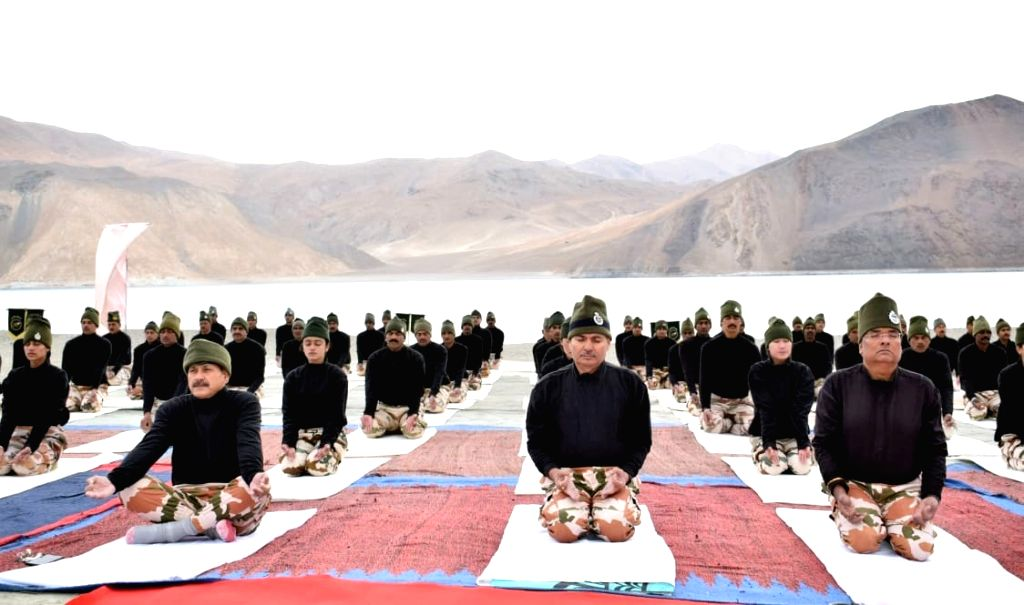Lukung: DG ITBP SS Deswal performs Yoga along with the jawans at the height of approx 14K Ft near Lukung at the banks of Pangong Tso, Laddakh, on the occasion of the 5th International Day of Yoga 2019 in Lukung on June 21, 2019. (Photo: IANS/PIB)
