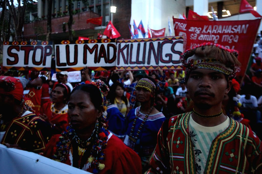 Lumad people, a group of indigenous people from Southern Philippines, participate in a protest rally in Quezon City, the Philippines, Oct. 28, 2015. Students ...