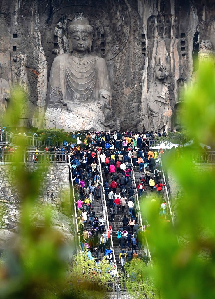 The Longmen Grottoes scenic spot is crammed with visitors in Luoyang, central China's Henan Province, April 5, 2015. The senic spot received more than 60,000 trips ...