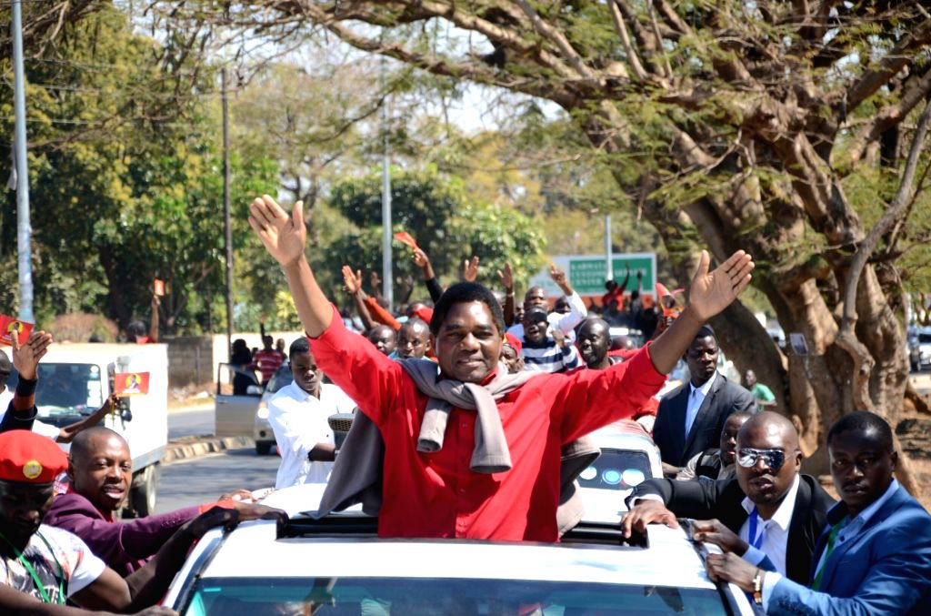 LUSAKA, Aug. 16, 2017 - Zambia's leading opposition leader Hakainde Hichilema (C) waves to the crowd after being released from prison in Lusaka, Zambia, Aug. 16, 2017. Zambia's leading opposition ...
