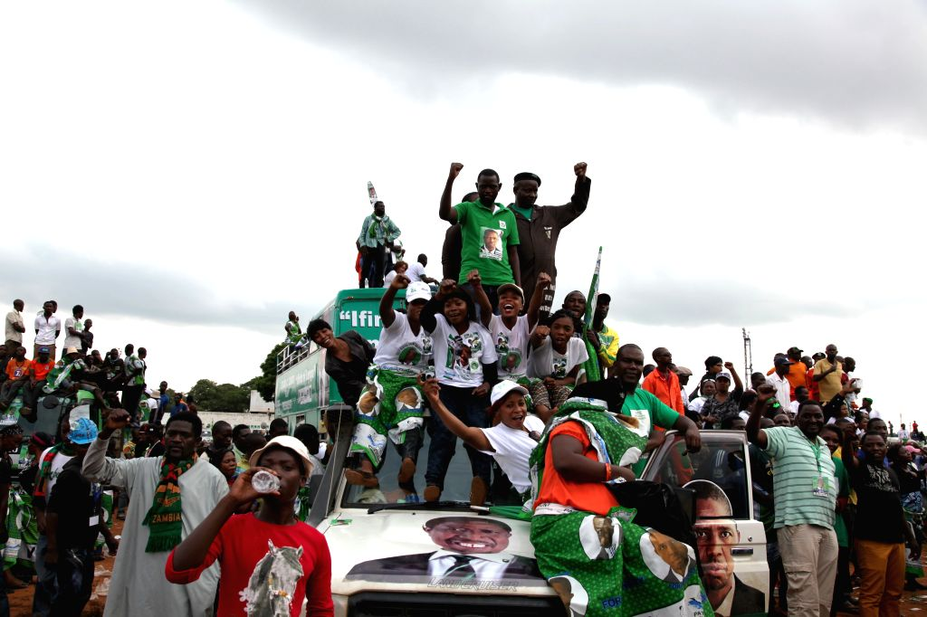 Supporters attend a rally of ruling Patriotic Front presidential candidate, Defense and Justice Minister Edgar Lungu at the Woodland Stadium in Lusaka, capital of ... - Edgar Lungu