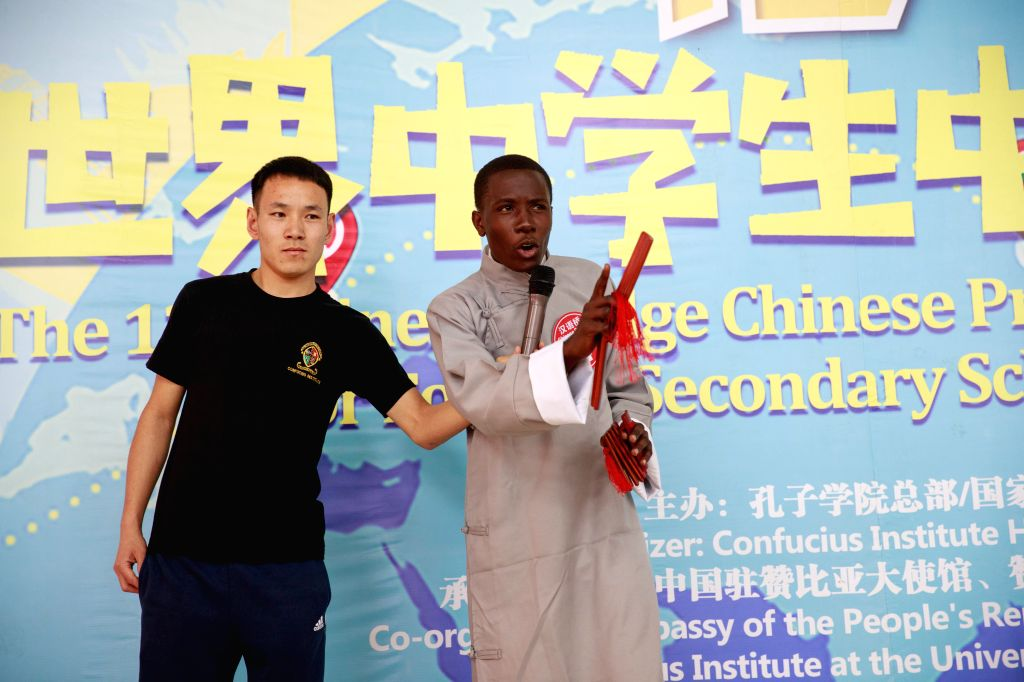 LUSAKA, July 20, 2019 - A Zambian student (R) performs during a Chinese proficiency contest in Lusaka, Zambia, July 19, 2019. Zambia's secondary school students from different parts of the country on ...