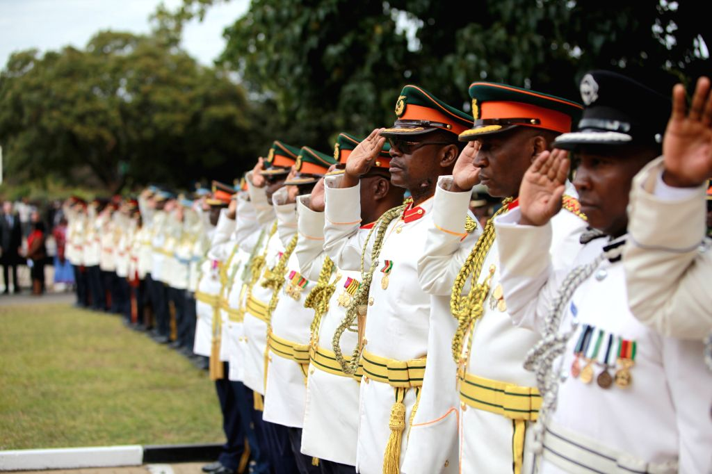 LUSAKA, May 25, 2016 - Officers and soldiers salute at the Freedom Statue during a wreath-laying ceremony in honor of fallen freedom fighters in Lusaka, capital of Zambia, May 25, 2016. Zambia ...