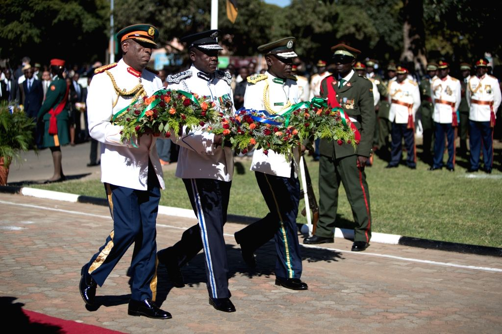 LUSAKA, May 25, 2017 - Zambian officers hold wreaths of flowers during a ceremony marking the Africa Day in Lusaka, capital of Zambia, May 25, 2017. Zambia held a grand ceremony on Thursday to mark ...