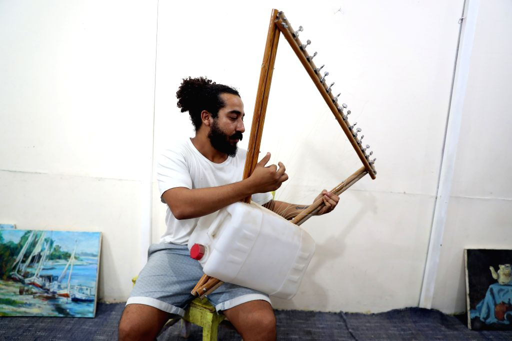LUXOR (EGYPT), Oct. 16, 2019 Shady Rabab, founder of the Garbage Music Band, uses garbage to make musical instruments in his workshop in Luxor, Egypt, on Oct. 11, 2019. TO GO WITH ...