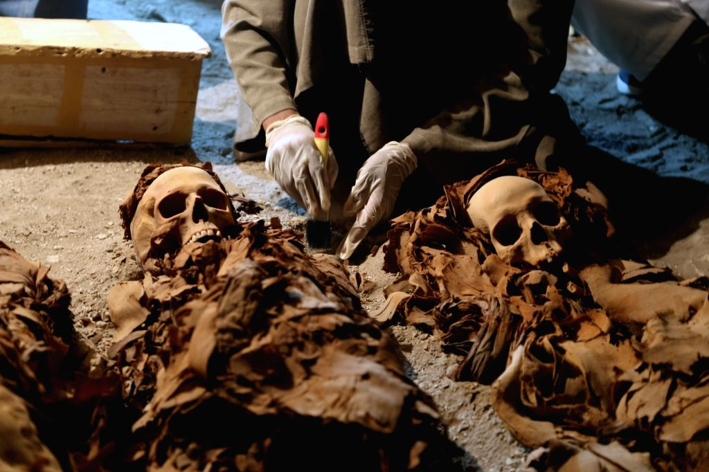 LUXOR (EGYPT), Sept. 10, 2017 An Egyptian archaeologist works on mummies at a newly discovered ancient tomb of God Amun's Goldsmith in Draa Abul-Naga necropolis on Luxor's West Bank, ...