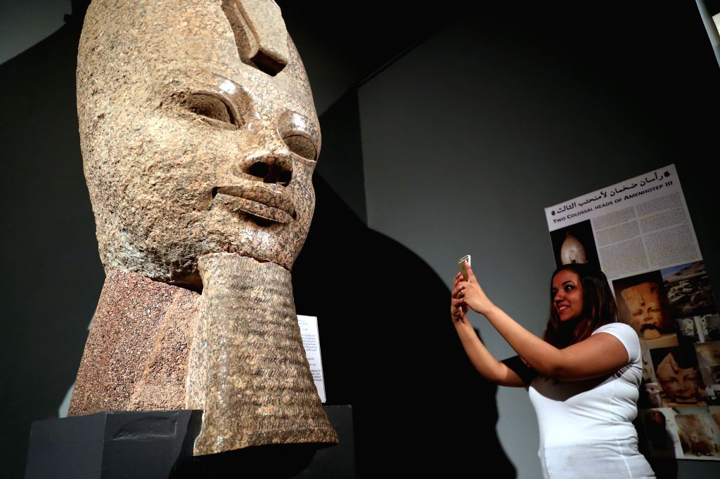 LUXOR (EGYPT), Sept. 11, 2019 A woman takes photos in Luxor Museum in Luxor, Egypt, on Sept. 8, 2019. The two-floor Luxor Museum overlooking the east bank of the Nile River in the heart ...
