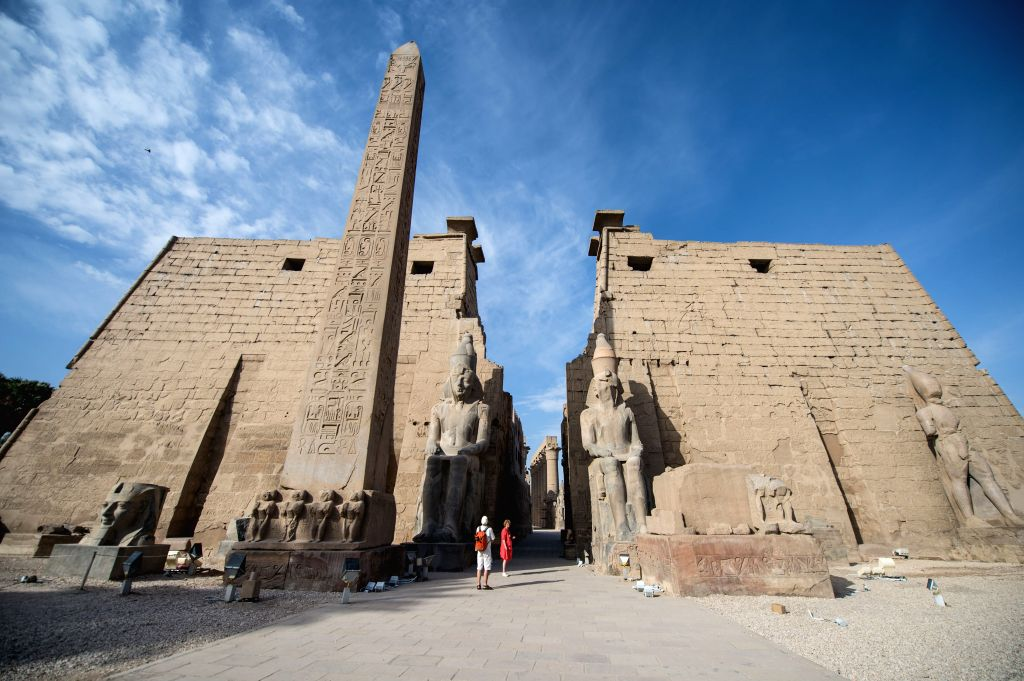 Tourists visit the Luxor Temple in Luxor, a tourist resort in south Egypt, on April 30, 2014.