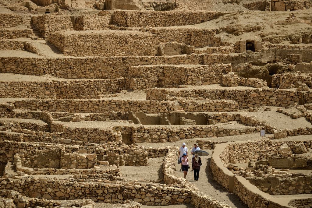 Tourists visit the site of Tomb of Sennutem in Luxor, a tourist resort in south Egypt, on April 30, 2014.
