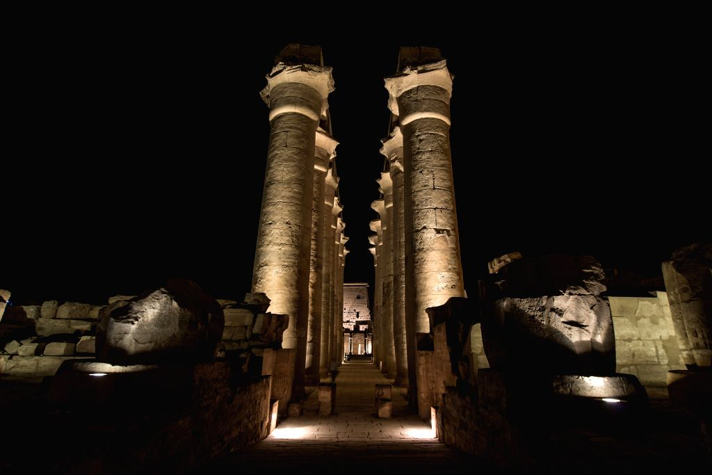 Statues in the Luxor Temple are seen illuminated at night in Luxor, a famous tourism destination in southern Egypt, on Nov. 17, 2014.