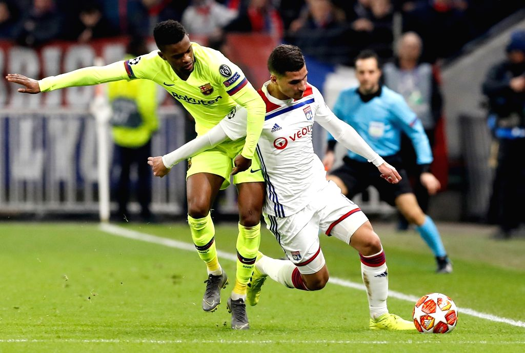 LYON, Feb. 20, 2019 - Houssem Aouar (R) of Lyon competes during the UEFA Champions League round of 16 first leg match between Lyon and Barcelona in Lyon, France, Feb. 19, 2019. The match ended 0-0.