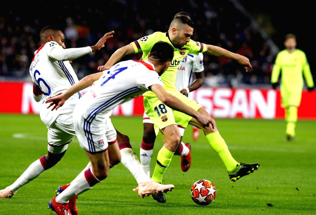 LYON, Feb. 20, 2019 - Jordi Alba (R) of Barcelona competes during the UEFA Champions League round of 16 first leg match between Lyon and Barcelona in Lyon, France, Feb. 19, 2019. The match ended 0-0.