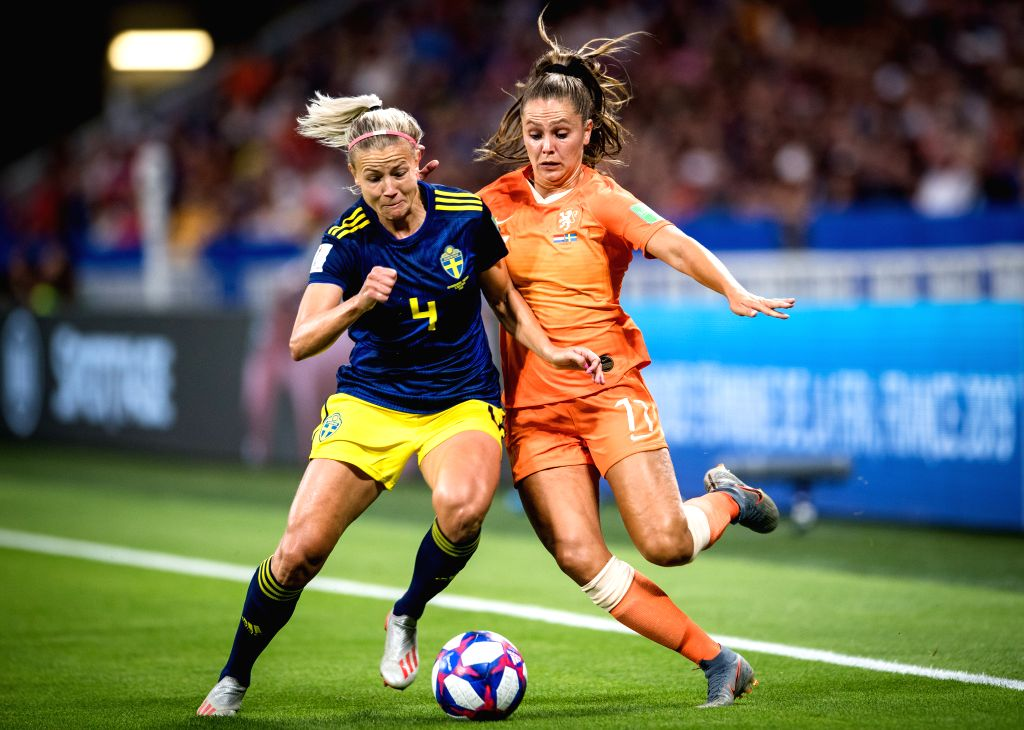 LYON, July 4, 2019 (Xinhua) -- Ellen Jansen (R) of the Netherlands vies with Hanna Glas of Sweden during the semifinal match between the Netherlands and Sweden at the 2019 FIFA Women's World Cup at Stade de Lyon in Lyon, France, July 3, 2019. (Xinhua