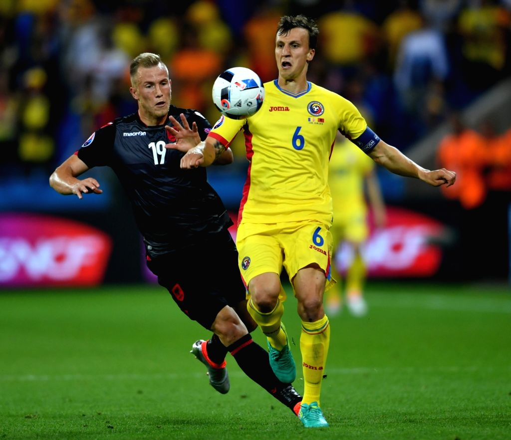 LYON, June 20, 2016 - Bekim Balaj (L) of Albania vies with Vlad Chiriches of Romania during the Euro 2016 group A soccer match between Romania and Albania in Lyon, France, June 19, 2016.