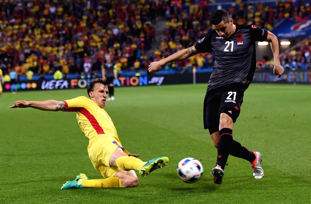 LYON, June 20, 2016 - Odise Roshi (R) of Albania competes during the Euro 2016 group A soccer match between Romania and Albania in Lyon, France, June 19, 2016.